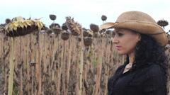 Cowboy Farmer Girl in Sunflower  field 04 Stock Footage
