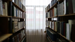 Shelves of books in library Stock Footage