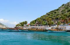 Kemer, Turkey - 06.20.2015. Pleasure boats for tourists near the pier - stock photo