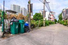 Outdoor trashcans near street in city. Stock Photos