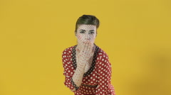 Girl in makeup shows different emotions on a bright yellow background in the - stock footage
