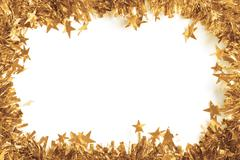 Christmas Gold Tinsel as a border isolated against a white background - stock photo