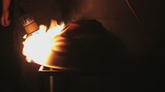 Brass metal processing with flames and high temperature on a light top Stock Footage