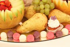 Delicious plate with sweets and fruits Stock Photos