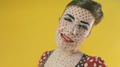 Woman in greasepaint of the heroine of comics grimacing in the studio on a Stock Footage