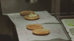 Fast food how to make a hamburger in a restaurant kitchen Stock Footage
