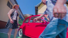 Opening the doors of a red yugo for the lady Stock Footage