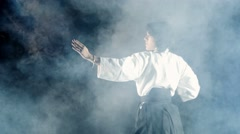 Stock Video Footage of 4k, beautiful girl doing aikido, smoke 2
