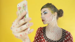 Girl with a professional makeup making selfie on the phone in the studio, the Stock Footage