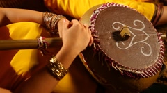 Female playing folk music on tambourine Stock Footage