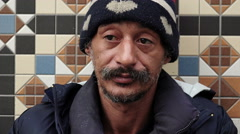 Close-up of an asian homeless begging for money on the street Stock Footage