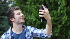 Rebel young man hipster take a selfie with a tablet - stock footage