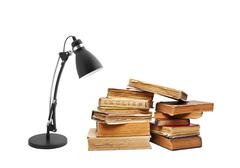 Old books with a lamp Stock Photos