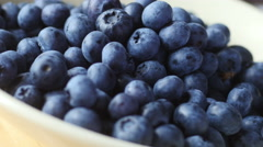 Fresh blueberries rotating in bowl, 4k, UHD Stock Footage