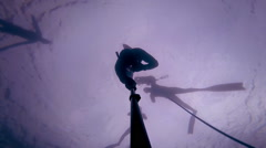 Freediver Descending at 60 feet deep and experiencing a Freefall. Stock Footage