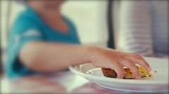 A boy eating a pizza for dinner at restaurant Stock Footage