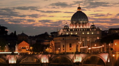 Panning shot of Sunset time-lapse of the Vatican City, from across the Tevere Stock Footage