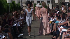 Fashion models walking on runway for Douglas Hannant Collection Stock Footage