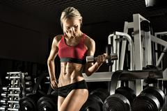 Fitness girl in gym Stock Photos