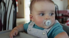 A cute boy in high chair at restaurant Stock Footage