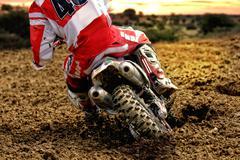 Motocross bike rider rear mud - stock photo