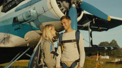 Couple is Talking on Airfield - stock footage
