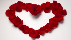 Stock Video Footage of 13 Valentine Day Heart Shape With Rose Petals. Zoom In