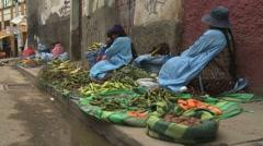 Women selling fruit in La Paz street market, Bolivia Stock Footage