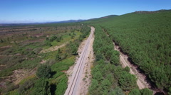 Railway and track in the wilderness, aerial view Stock Footage