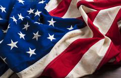 Old American Flag on wooden plank background Stock Photos