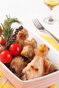 Roasted chicken drumsticks in a casserole dish Stock Photos