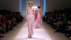 Fashion models walking on runway for Georger Chakra Collection Stock Footage