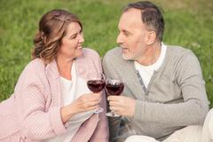 Pretty senior husband and wife are celebrating their anniversary - stock photo
