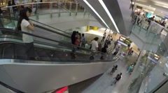 People going down by escalator Stock Footage