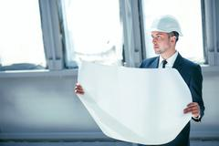 Attractive architect is planning to build new construction - stock photo