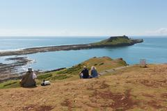 Worms Head Rhossili The Gower peninsula Wales UK with people - stock photo