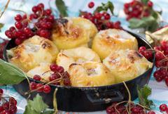Appetizing baked apples with fresh Kalina - stock photo