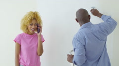 4K Happy couple in new home, woman gets good news from a phone call - stock footage