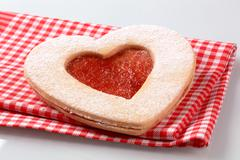 Heart shaped  Linzer cookie with jam filling - stock photo