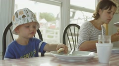 A mother and child eating a pizza for dinner at restaurant Stock Footage