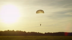 Shot of Landing Skydivers in Sunset Light - stock footage