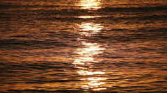 Bright solar path on the orange water surface. Stock Footage