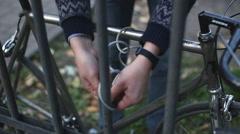 Man puts the unlock on the bike Stock Footage