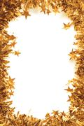 Christmas Gold Tinsel as a border isolated - stock photo