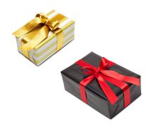 Gift box in gold duo tone with golden satin ribbon Stock Photos