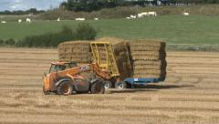 Machine loads bales on trailer. Stock Footage