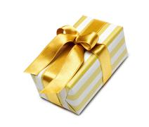 Gift box in gold duo tone with golden satin ribbon - stock photo