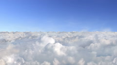 Loopable flight above the clouds - stock footage