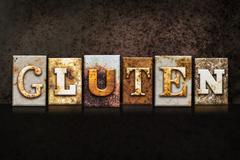 Gluten Letterpress Concept on Dark Background Stock Photos