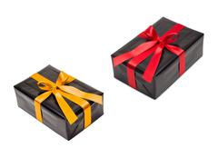 two gift boxes with yellow and red satin ribbon - stock photo